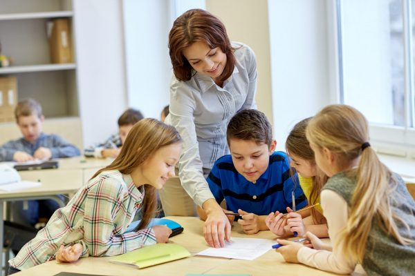 14278630-group-of-school-kids-writing-test-in-classroom-scaled.jpg